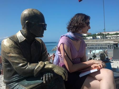 Student with statue in Copacabana