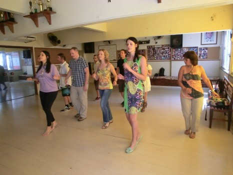Portuguese language students learning samba.