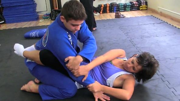 Jiu-Jitsu Brasileiro, student training with her master.