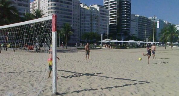playing beach football in copacabana