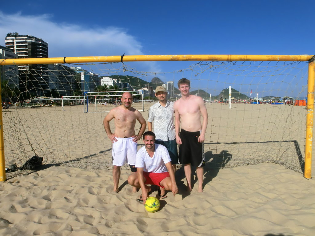 Foreign Portuguse language students ready to play football on the beach