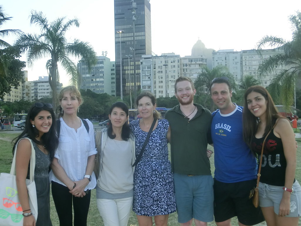 Group of students and Christ teh redeemer at the corner. Learn Portuguese and discover Rio de Janeiro with RioLIVE! Activities by Rio & Learn Portuguese School.