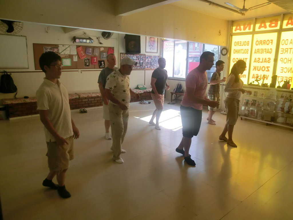 students speaking Portuguese while dancing samba