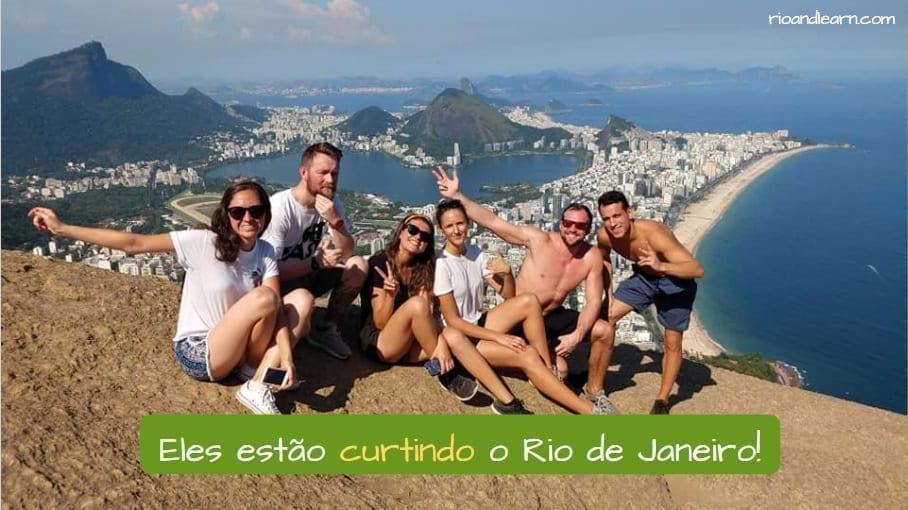 Verb Curtir in Portuguese. Eles estão curtindo o Rio de Janeiro.