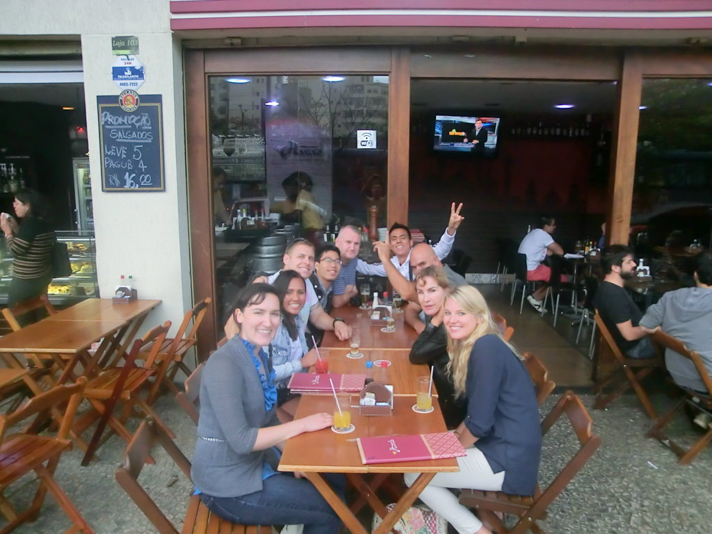 Portuguese students learning Brazilian Portuguese while drinking a beer