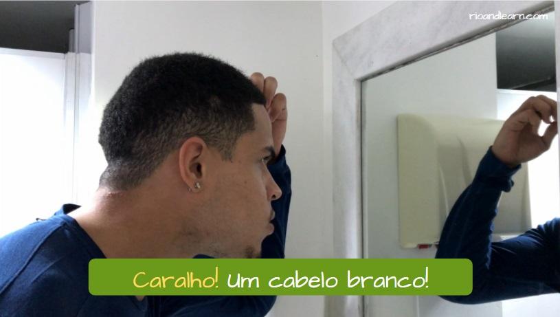 Portuguese word Caralho. Caralho! Um cabelo branco!