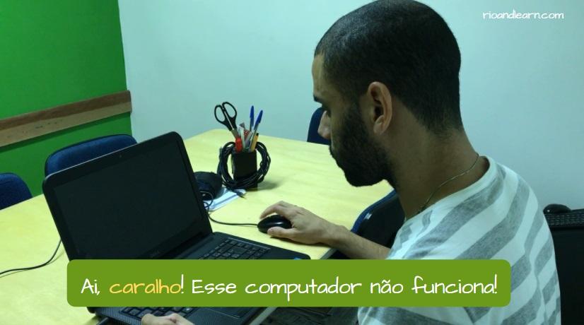 Portuguese word Caralho. Caralho! Esse computador não funciona!