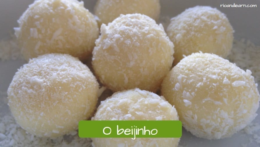 Brazilian Sweets and desserts. O beijinho: coconut ball with condensed milk.