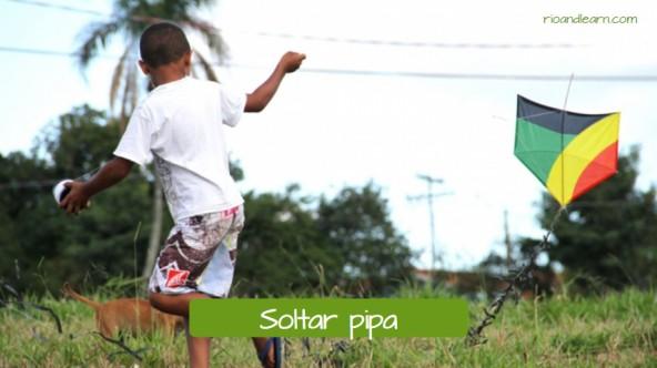 Example of children's games in Brazil: Soltar pipa.