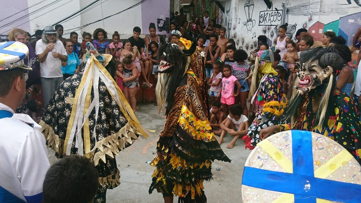 People wearing costumes in three kings day in Brazil.