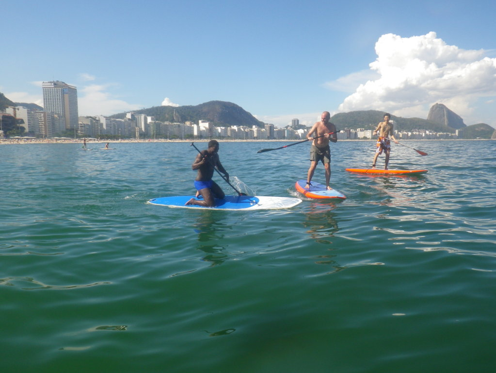 Laughing together with the Stand Up Paddle Surf First Experience in Copacabana Beach