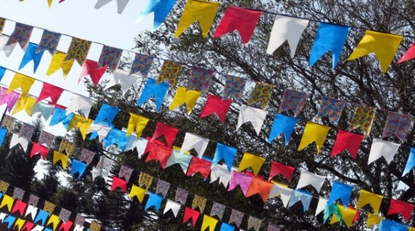 Decoration with colorful little flags at Festa Junina, june festival in Brazil.