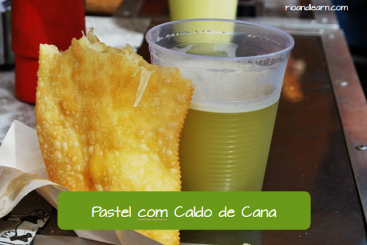 Street Food in Brazil: Pastel com caldo de cana. Pastel with Sugarcane juice