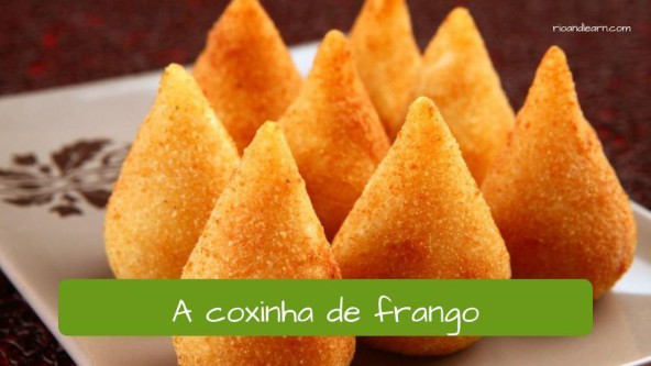 Different kinds of snacks in Brazil: a coxinha de frango.