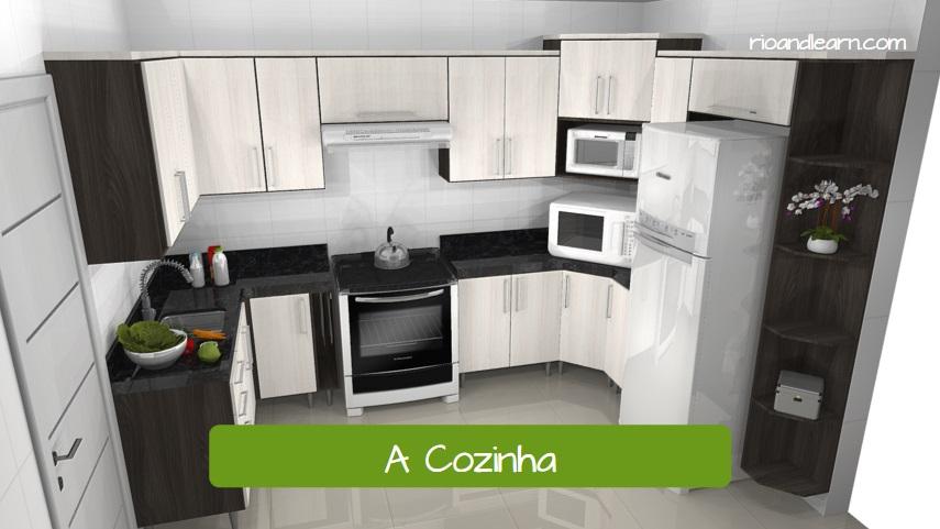 A Cozinha. The kitchen. Cozinha pequena e clara com armários de madeira.
