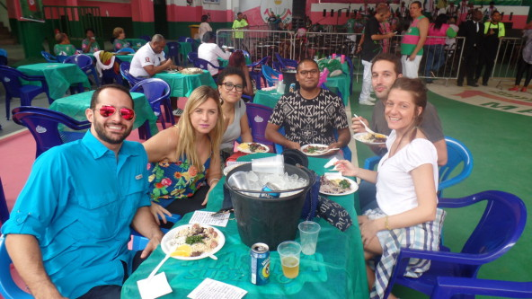 Portuguese language students enjoying feijoada at Mangueira samba school