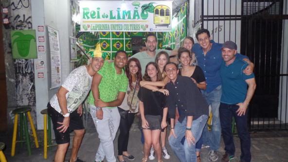 Portuguese language students learning how to make caipirinhas at Rei do Limão.