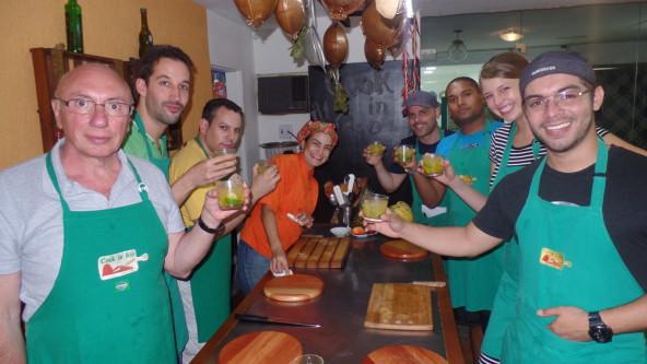 Brazilian Portuguese students ready to cook moqueca in Copacabana.
