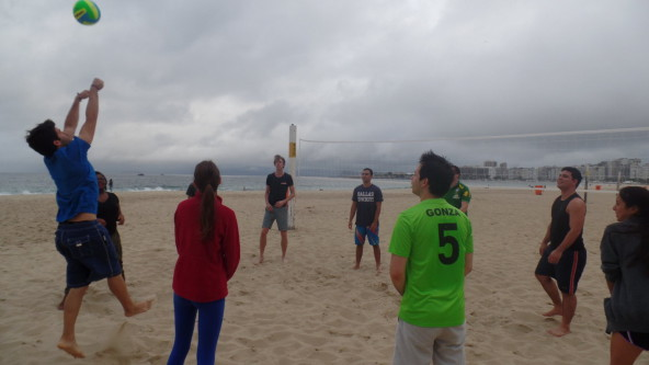 Students playing beach volley at Copacabana beach.