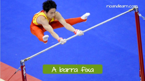 Artistic Gymnastics Equipments in Portuguese. The horizontal bar: A barra fixa. Athlete with red uniform participating on the horizontal bar during the olympic games.