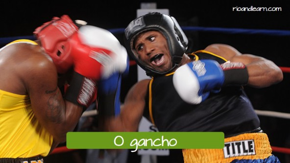 Vocabulary of boxing moviments. O gancho: The upper or uppercut.