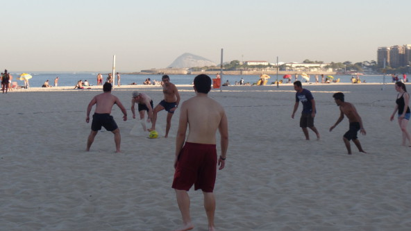Portuguese students playing soccer at Copacabana.