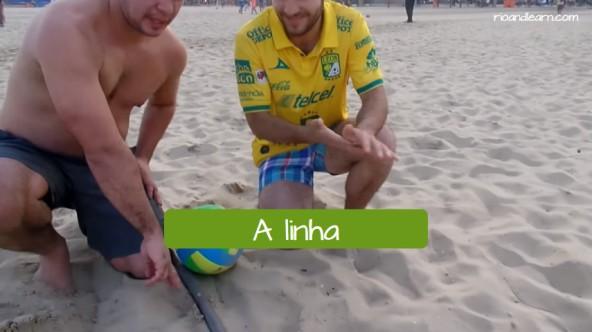Beach volleyball in Rio de Janeiro. The line in Portuguese: A linha.