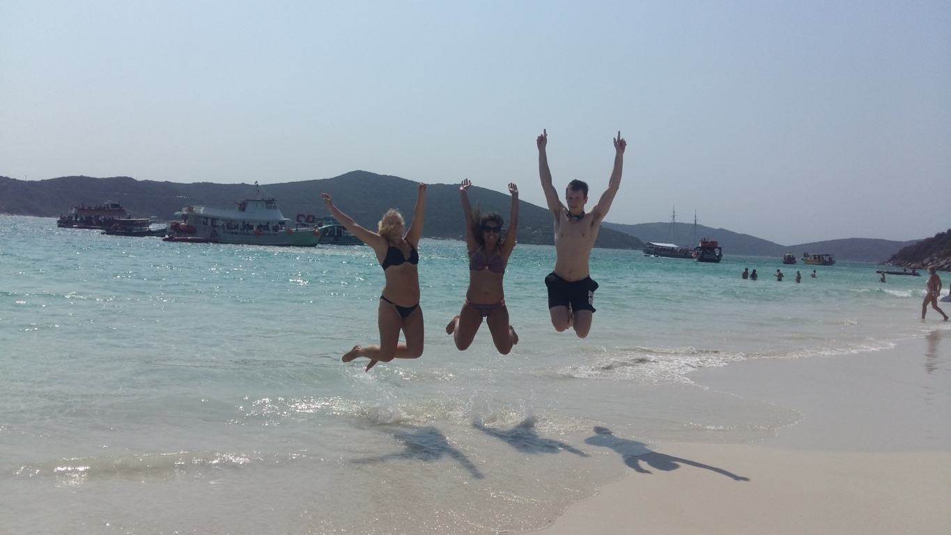 Beauties from Arraial do Cabo. Students jumping on the beach.