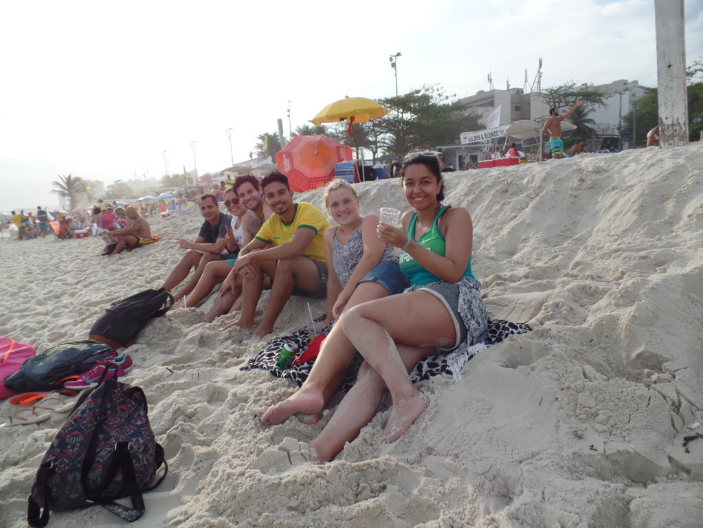 Enjoying beaches - Students relaxing and drinking caipirinhas