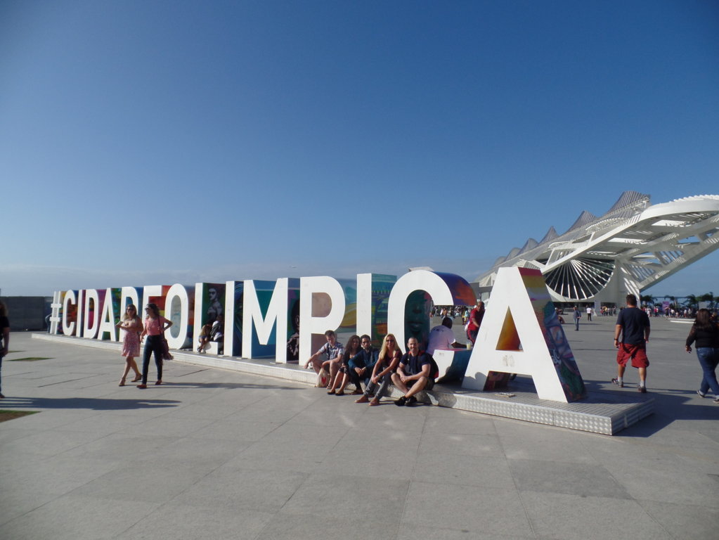 Visiting Porto Maravilha. Students in front of Museu do Amanhã in a sunny and beautiful day.