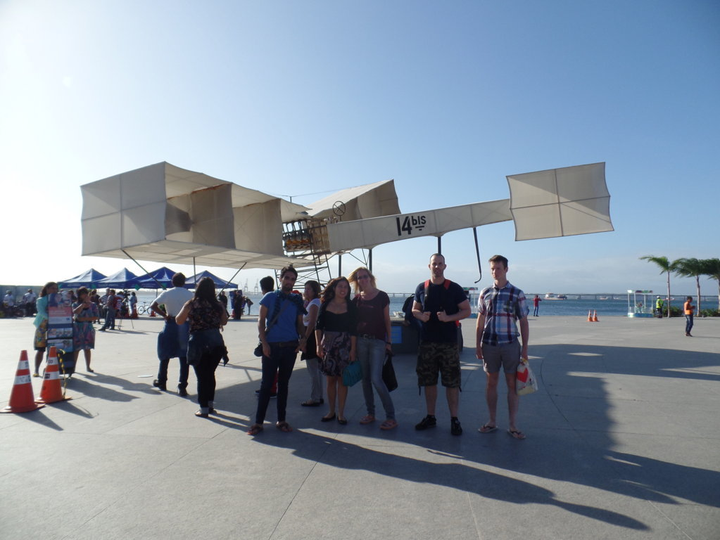 Visiting Porto Maravilha. Students posing in front of the first plane created by Santos Dumont.