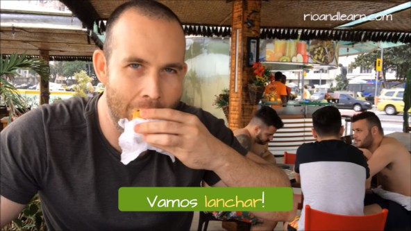 Lanche meaning in Portuguese. Example with the verb Lanchar in Portuguese: Vamos lanchar!