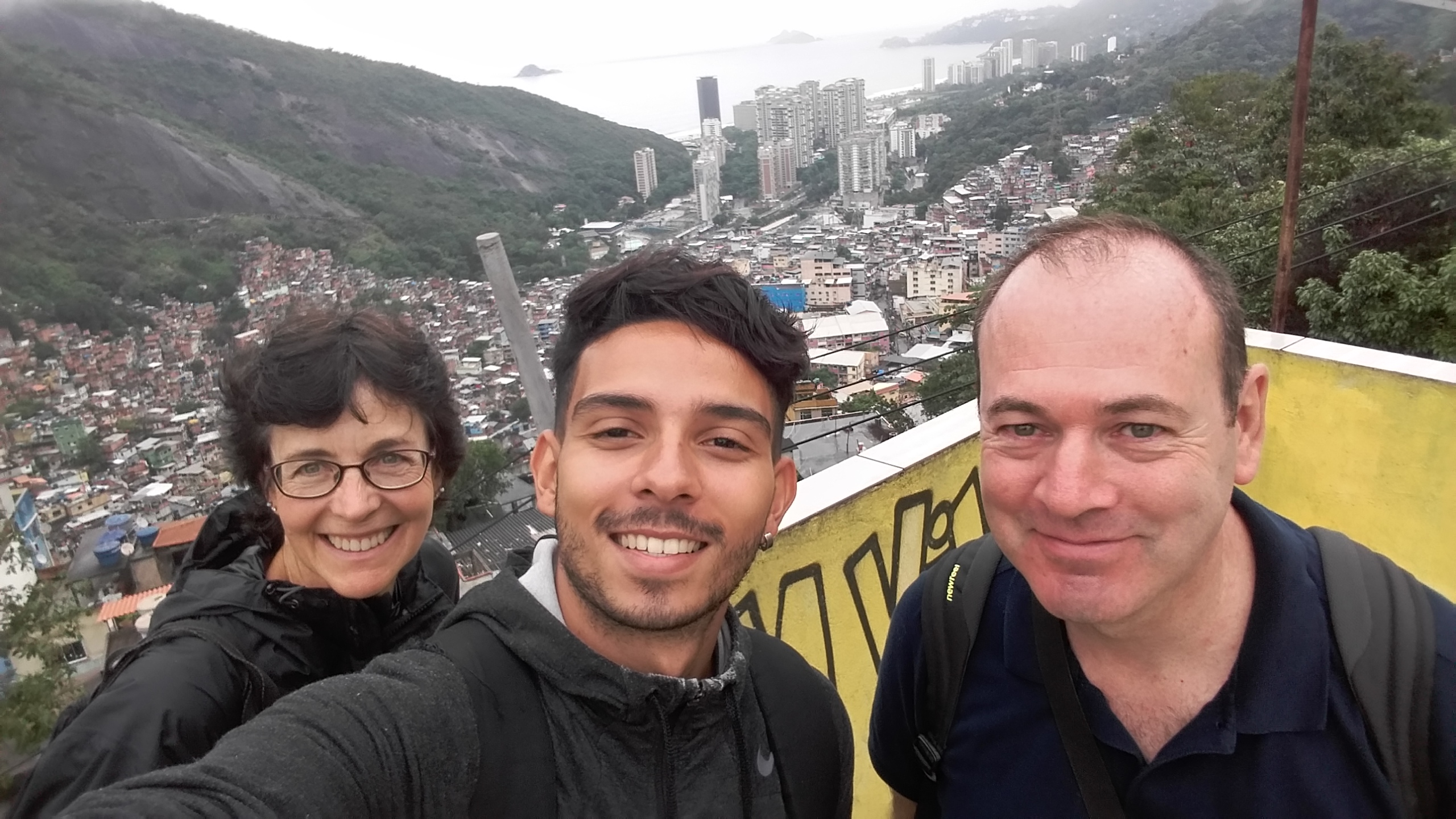 Wonderful Rocinha. Students on a slab with panoramic view of the favela. From there it is possible to look how big this favela is and also its several types of houses.