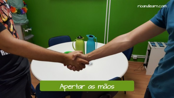 Formal greeting. Shake hands. Apertar as mãos