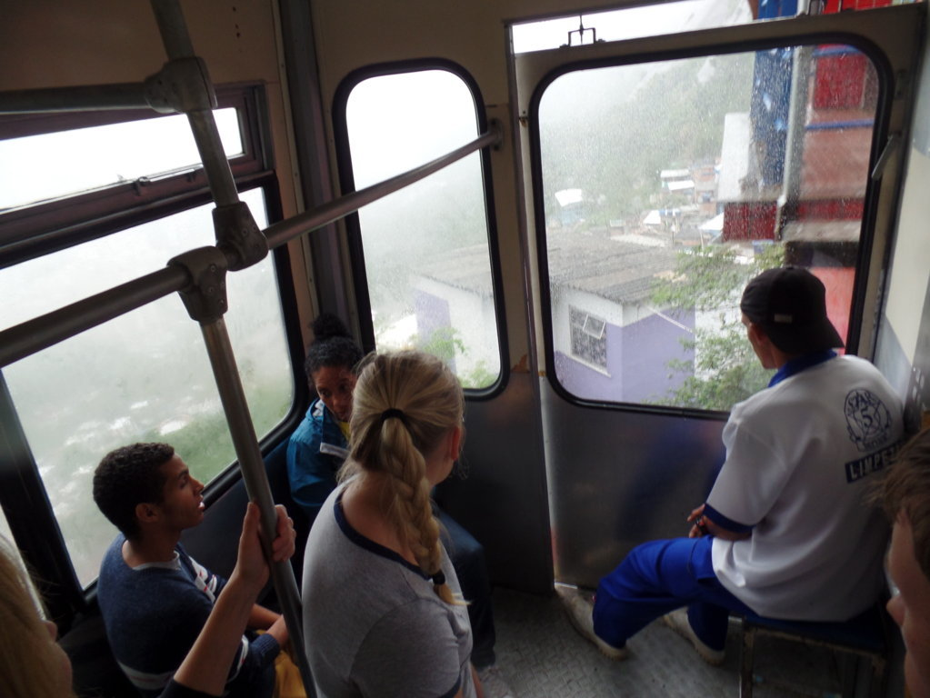 Day at Santa Marta. Students into the cable car, looking how big the favela is.