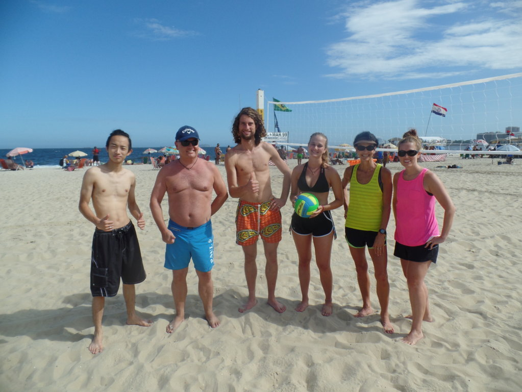 Great day at the beach. Students playing beach Volley.
