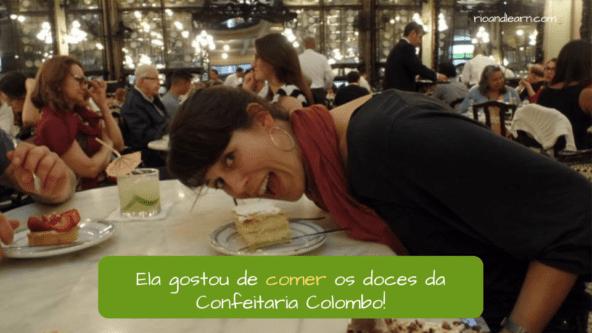 Ela gostou de comer os doces da Confeitaria Colombo! verbo comer em português.