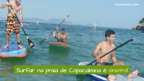 What does Sinistro mean in Portuguese. Surfar na praia de Copacabana é sinistro!