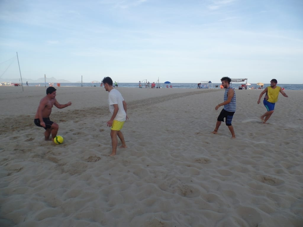 Play Football in Copacabana.