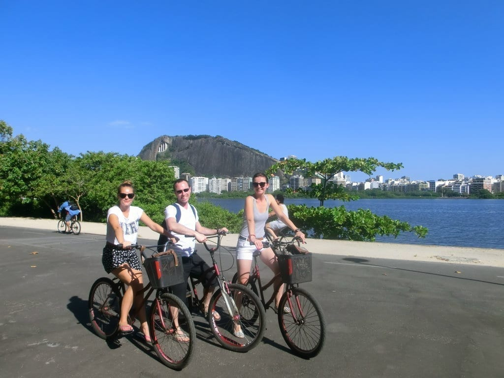 Students riding their bikes around Rodrigo de Freitas Lagoon.
