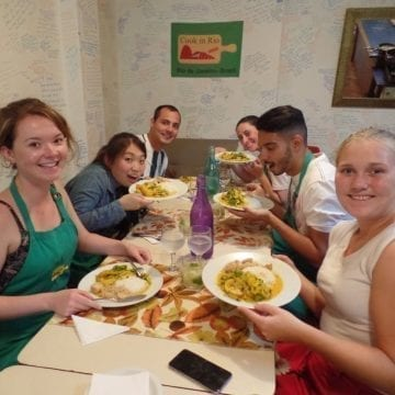 Brazilian Cuisine Class. Students ready to eat moqueca.
