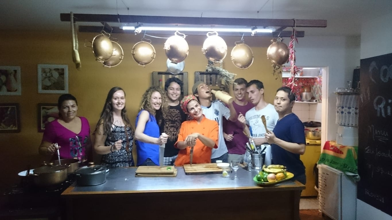 Brazilian cooking class in Rio. Brazilian Portuguese students ready to cook moqueca in Copacabana.