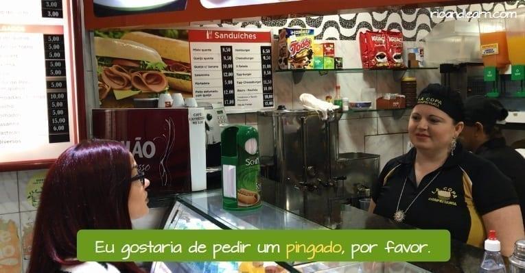 What is a pingado in Brazil. Eu gostaria de pedir um pingado, por favor.