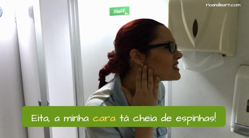 Meaning of cara in Portuguese. Eita! A minha cara tá cheia de espinhas!