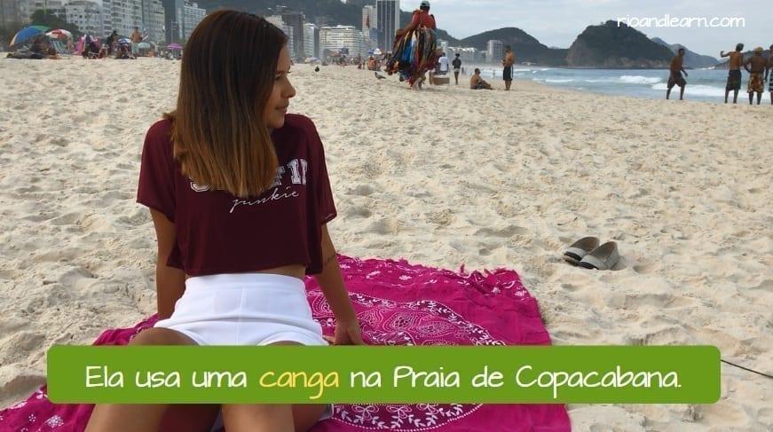 What is a canga. Ela usa uma canga na Praia de Copacabana.