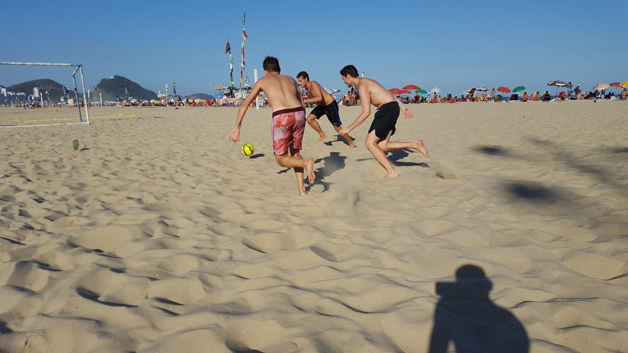 Beach Soccer in Copacabana. Students playing football in Copacabana Beach.