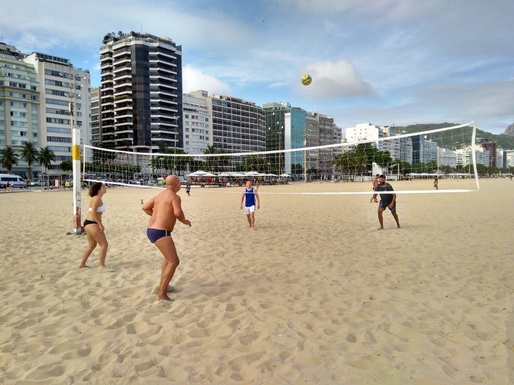 Foreigners playing beach volley on the beach.