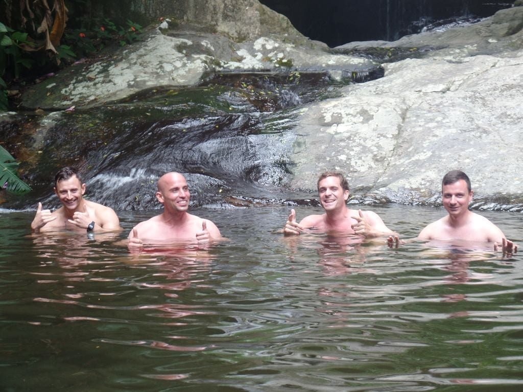 Enjoying the waterfall at Tijuca Forest.