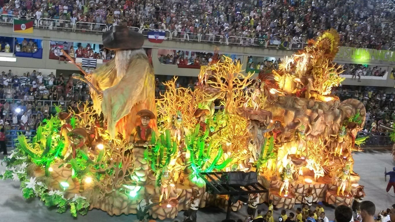 Rio Carnival Tickets. Alegoric car passing by the avenue showing the beauty of Carnival.