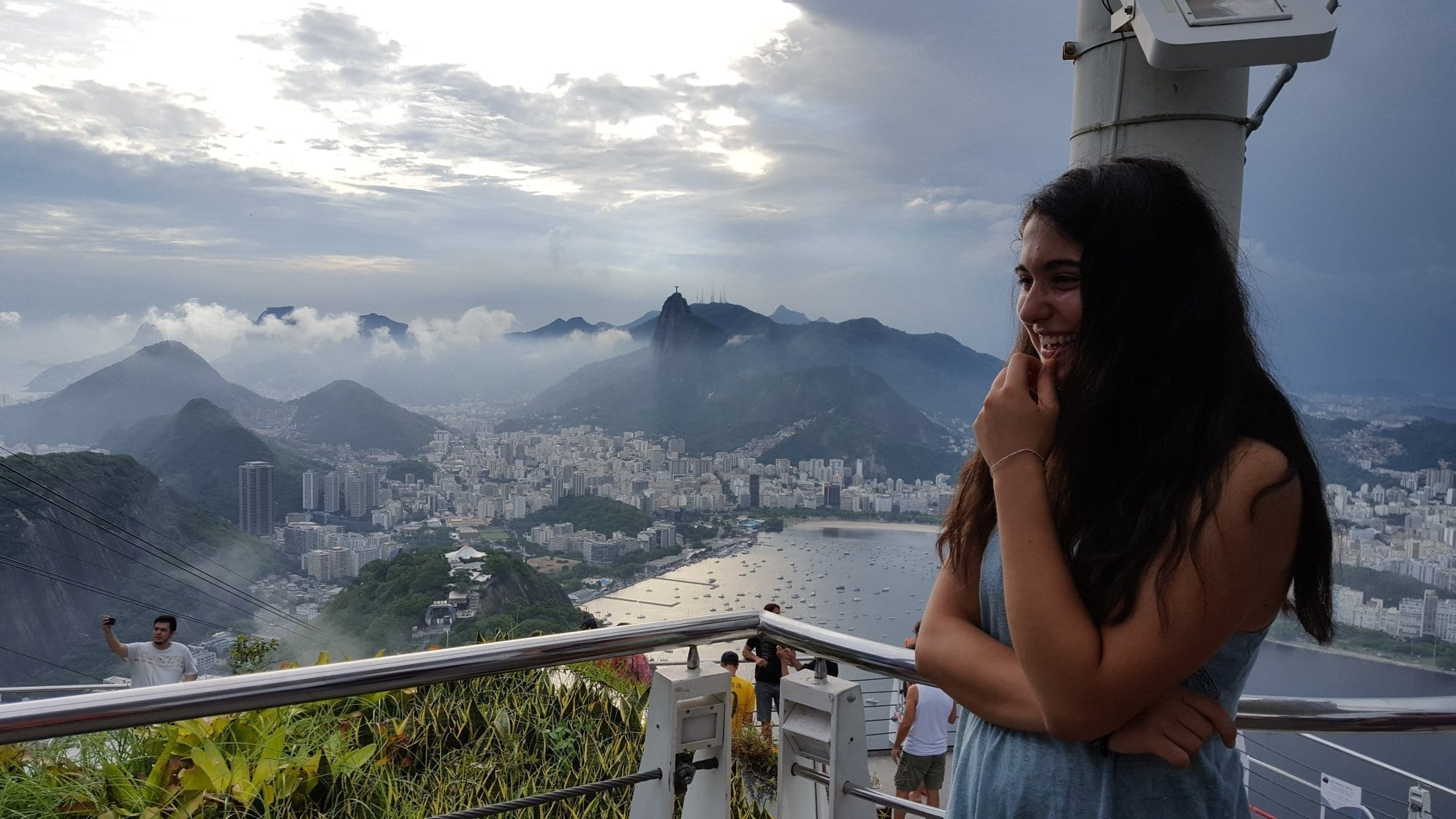 This view makes anyone smile! Dutch student at the top of Sugarloaf mountain.